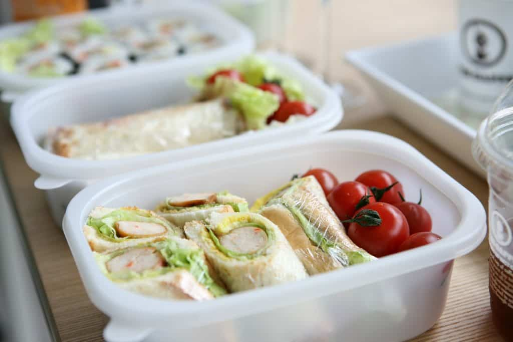 sandwich and cherry tomatoes in plastic lunchbox