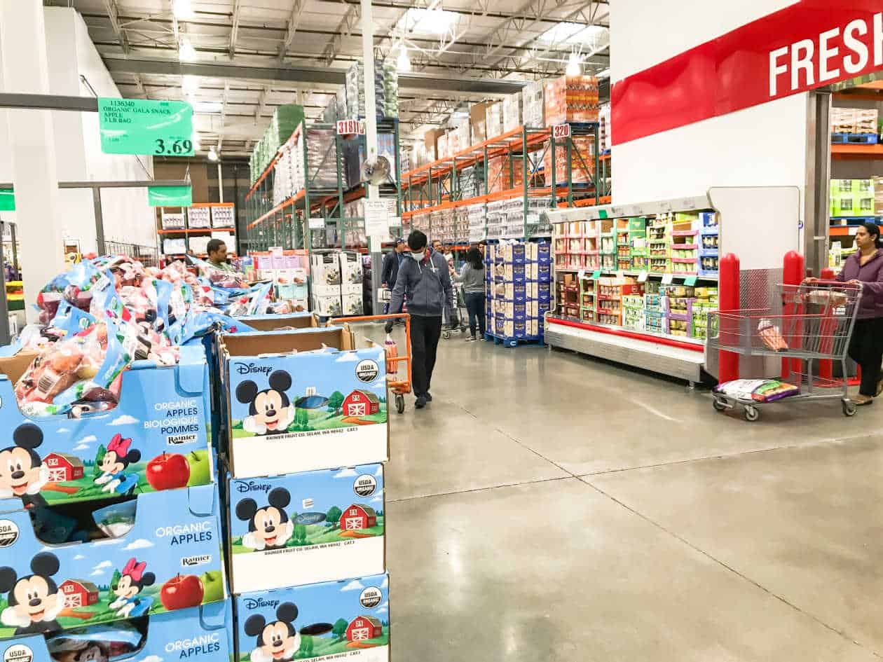 wide view of Costco produce department and people shopping