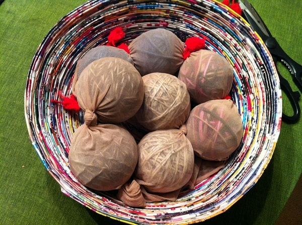 diy homemade wool dryer balls in pantyhose and ready for felting