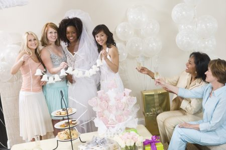Bridal shower on a budget - Friends taking photos at a bridal shower tea party