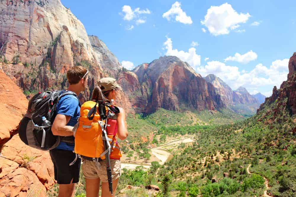 Couple hiking in Zion National Park on a road trip
