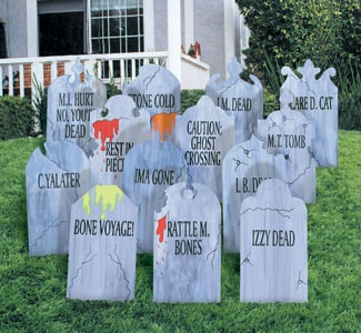 Tombstones in yard with funny sayings