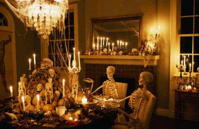 Skeletons at a dining table in haunted house Halloween