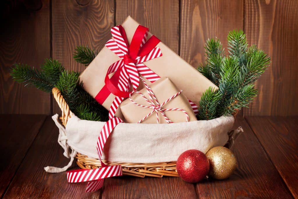 Christmas gifts and tree branch