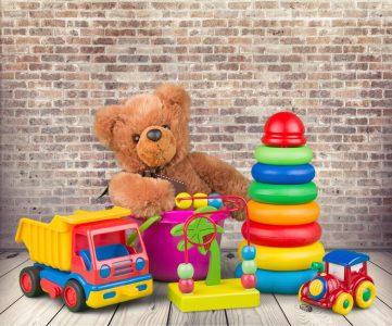 Children's toys including teddy bear, plastic rings, truck