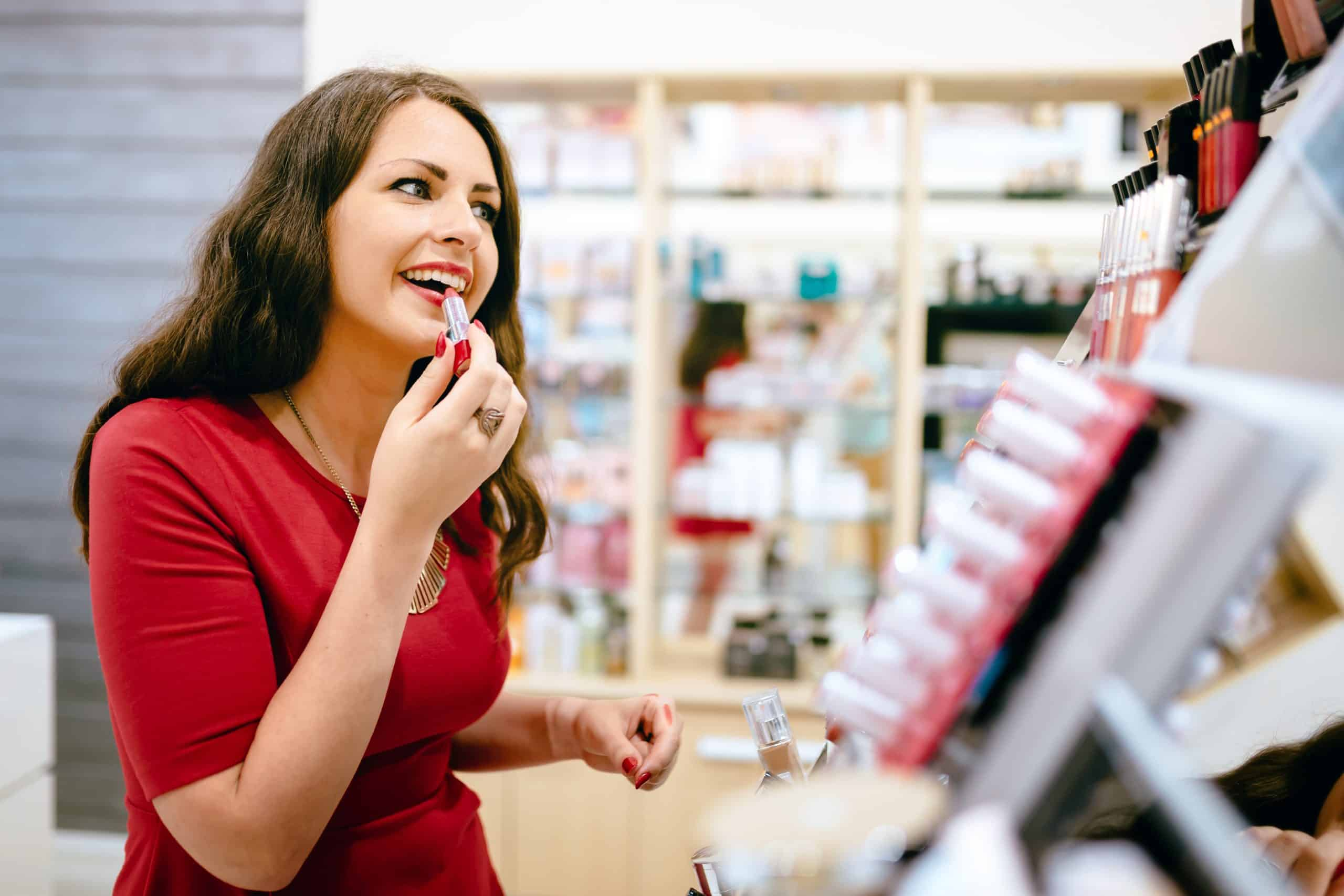 Beauty freebies - Woman trying cosmetics products in shop
