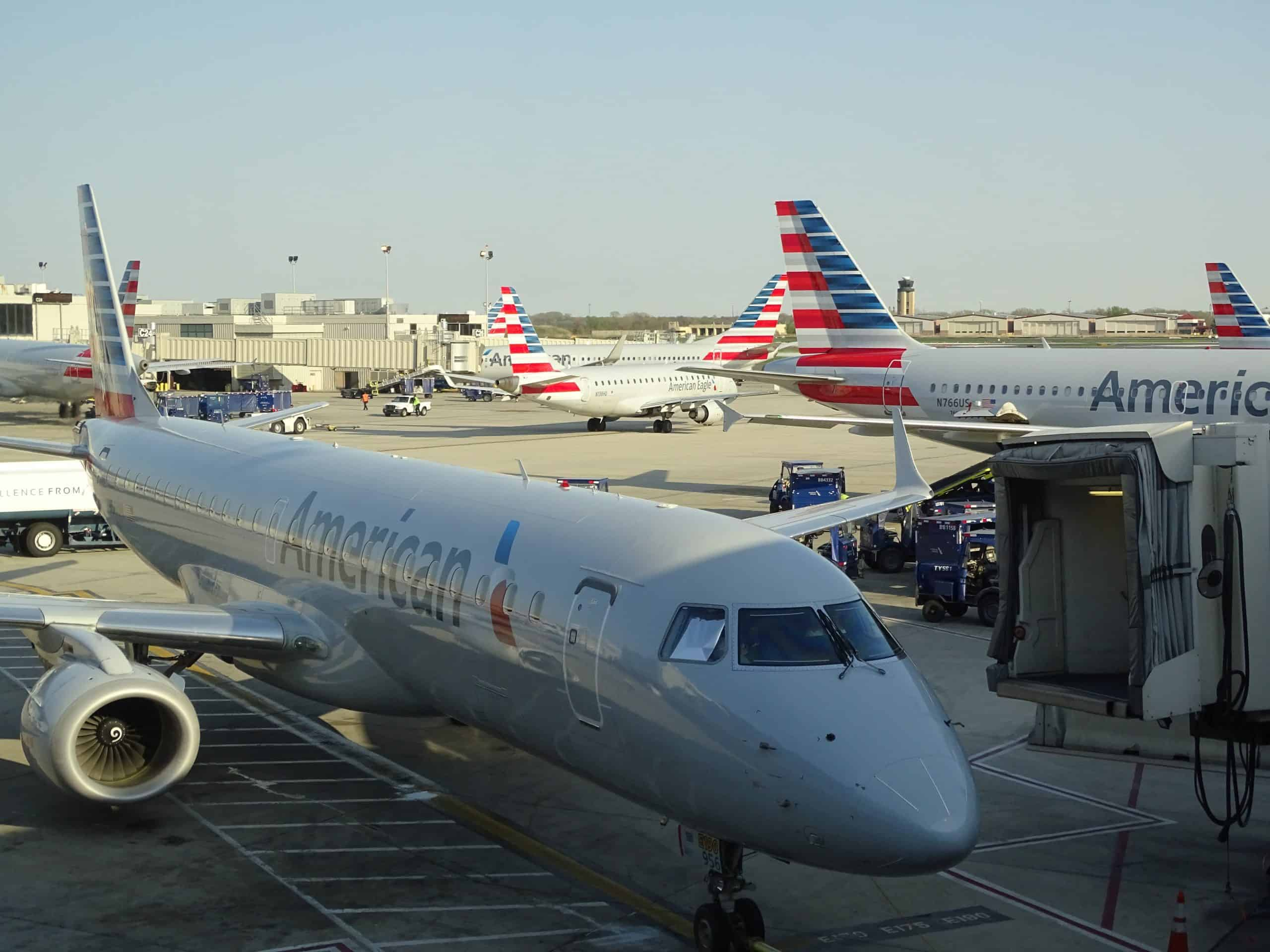 Earn miles and points to travel for less - photo of American Airlines plane at the airport