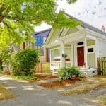 Buying a home - Small cute craftsman American house wth green and white