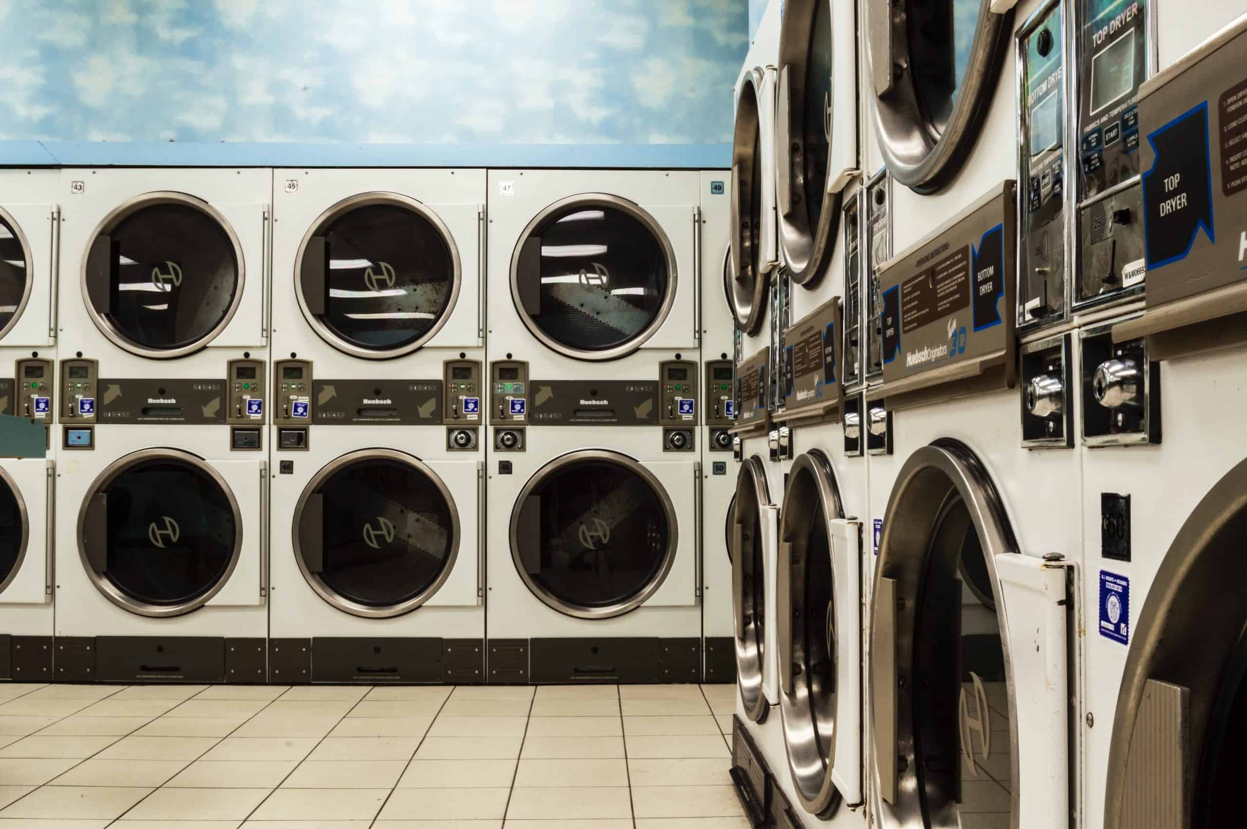 save money on laundry - laundromat row of washers and dryers