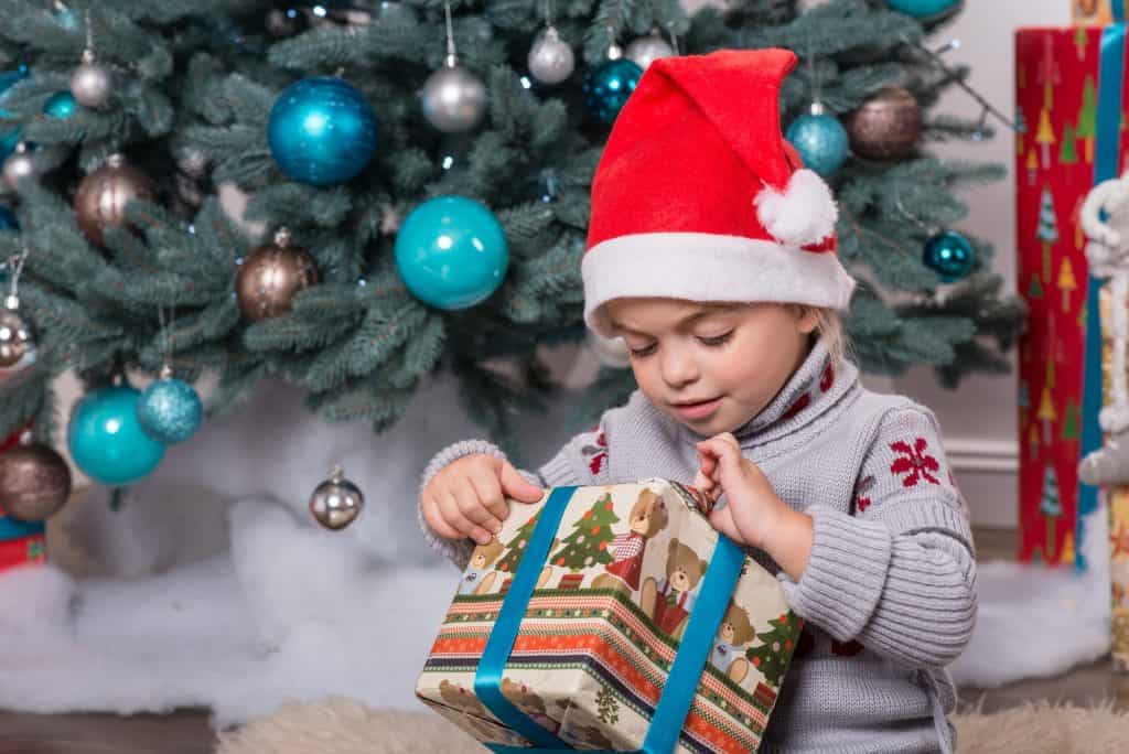 child-opening-present-christmas