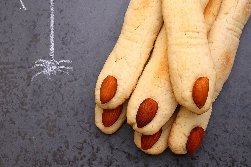 Halloween snack of shortbread fingers with almond nails