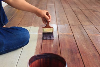 staining a deck with paint brush