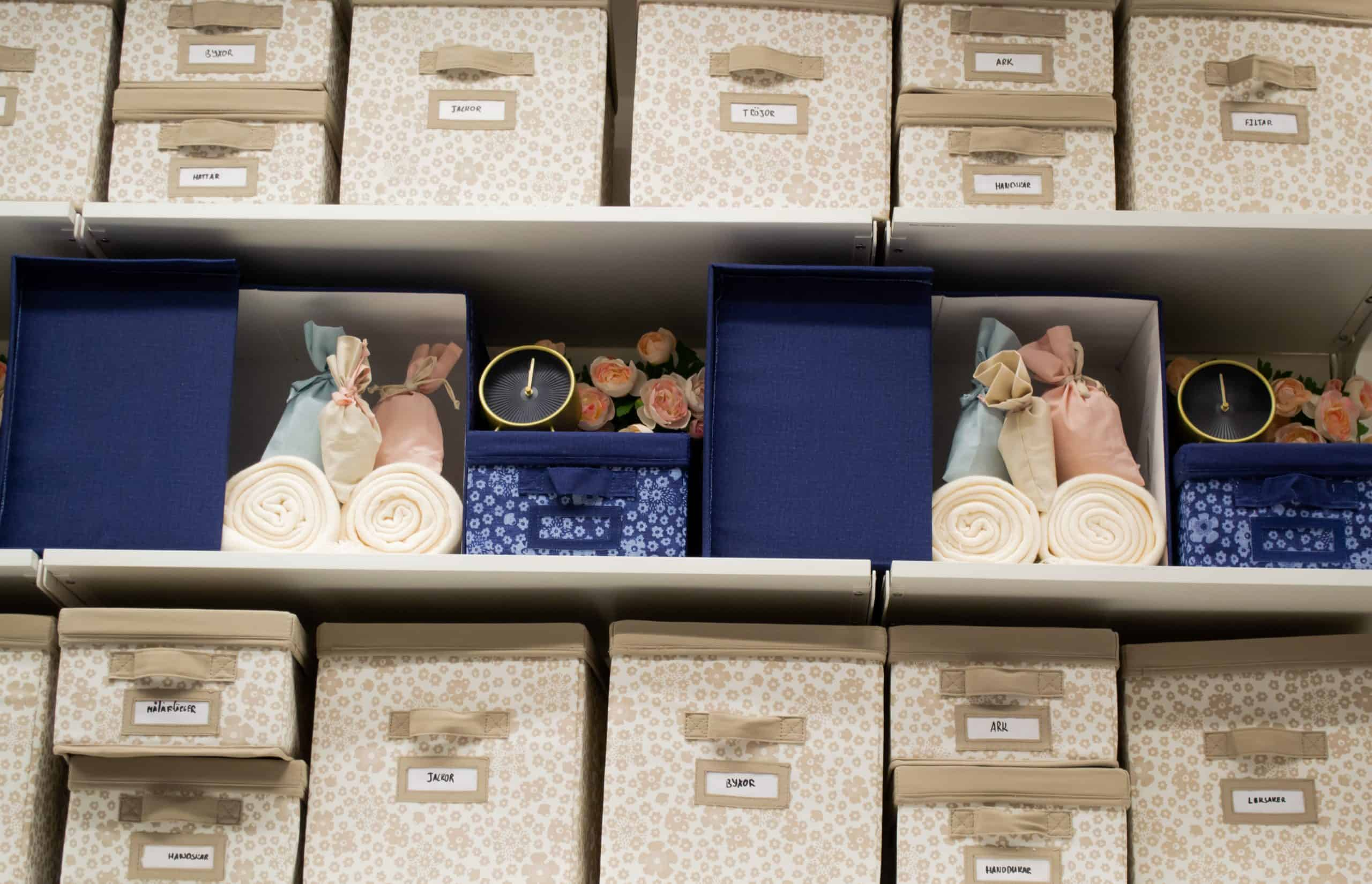 How to organize gift closet - photo of beige and blue textile storage boxes in a closet