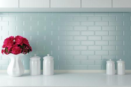 Minimalist kitchen with tile backsplash