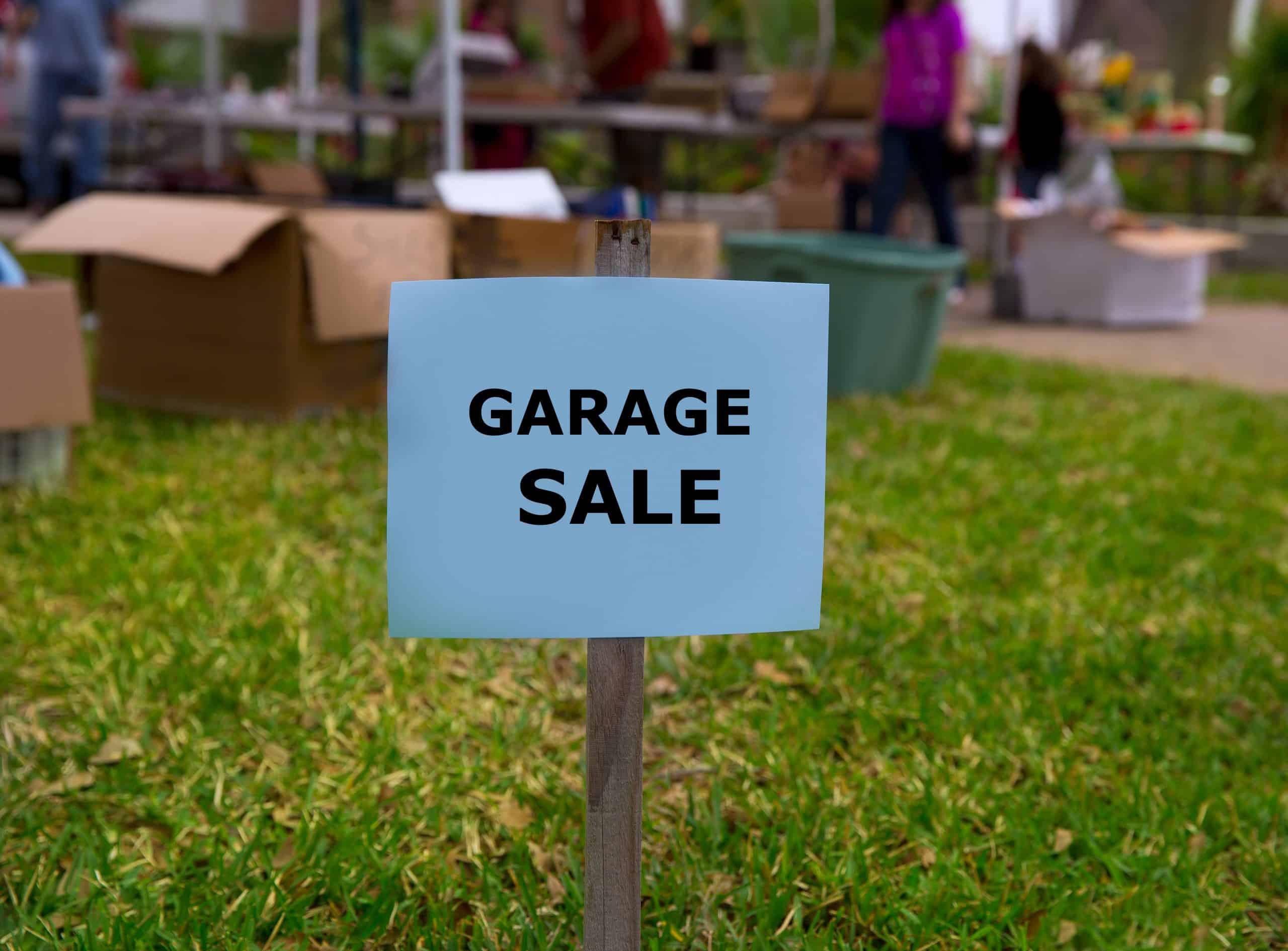 Make money garage sale - Garage sale in an american weekend on the yard green lawn