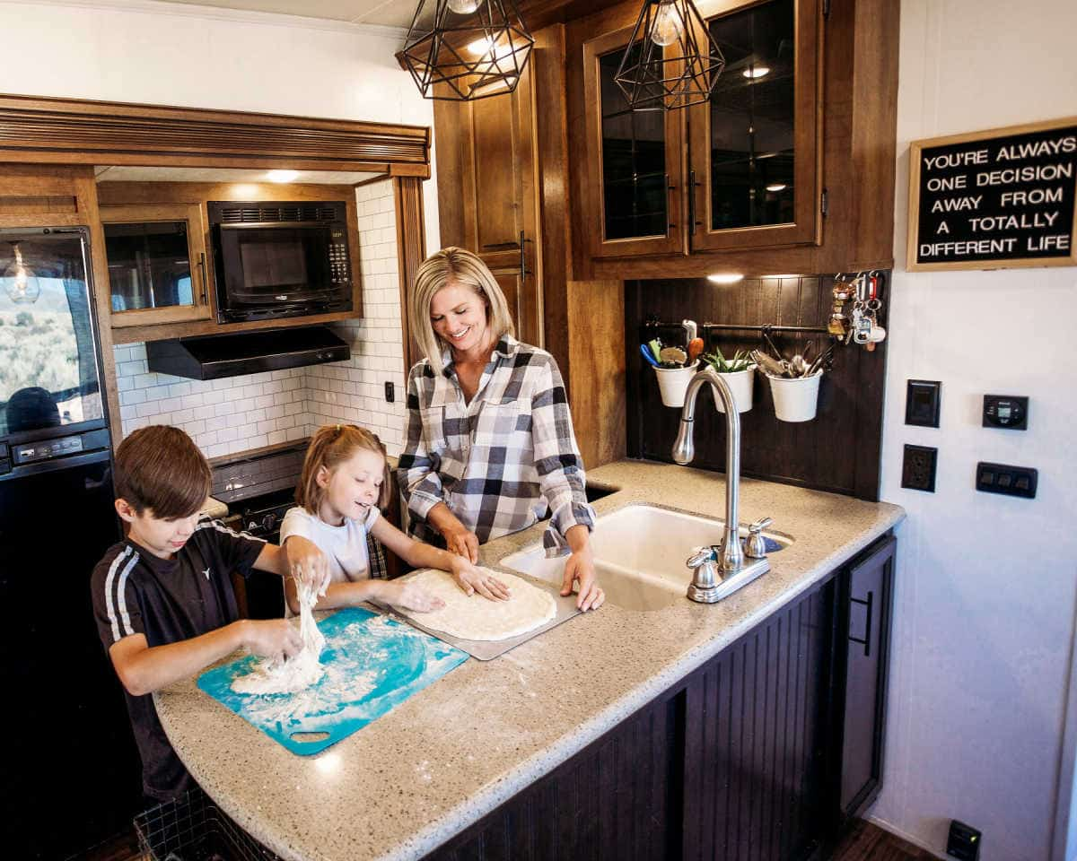 Family cooking in their RV rental