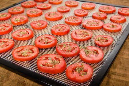 sliced tomatoes on drying trays