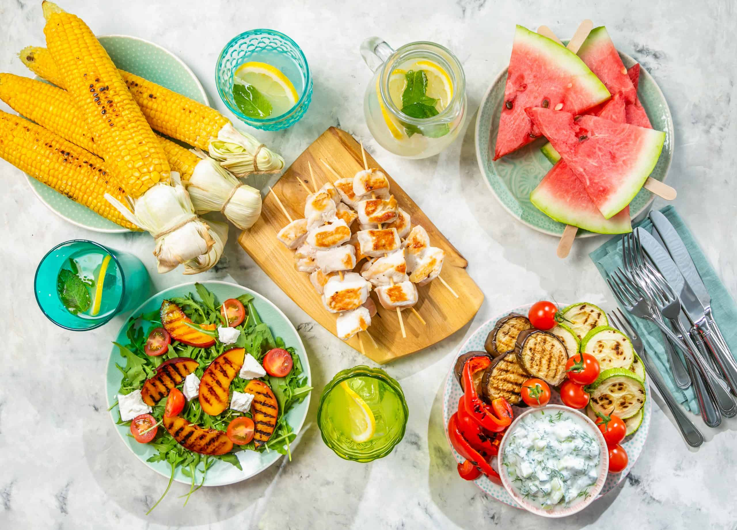 Barbecue leftovers - Summer bbq party table set with grilled chicken, vegetables, corn, salad