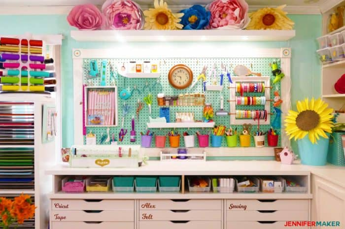 colorful and organized craft room peg board at JenniferMaker.com