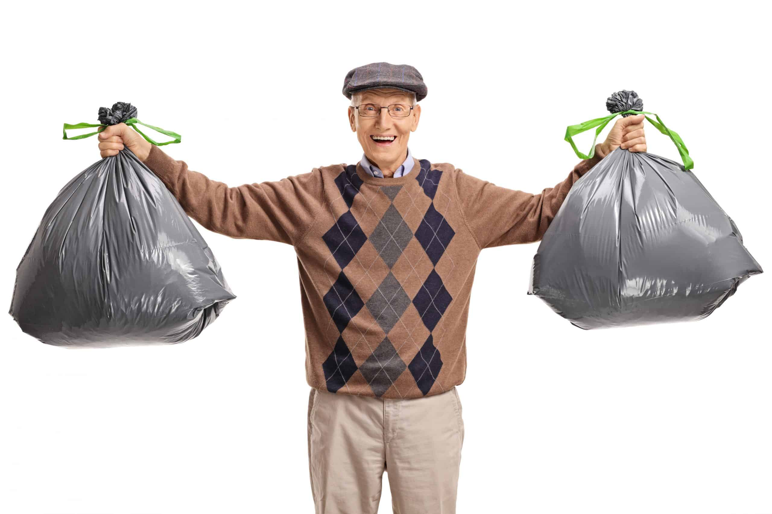 Declutter your home - Senior with garbage bags isolated on white background