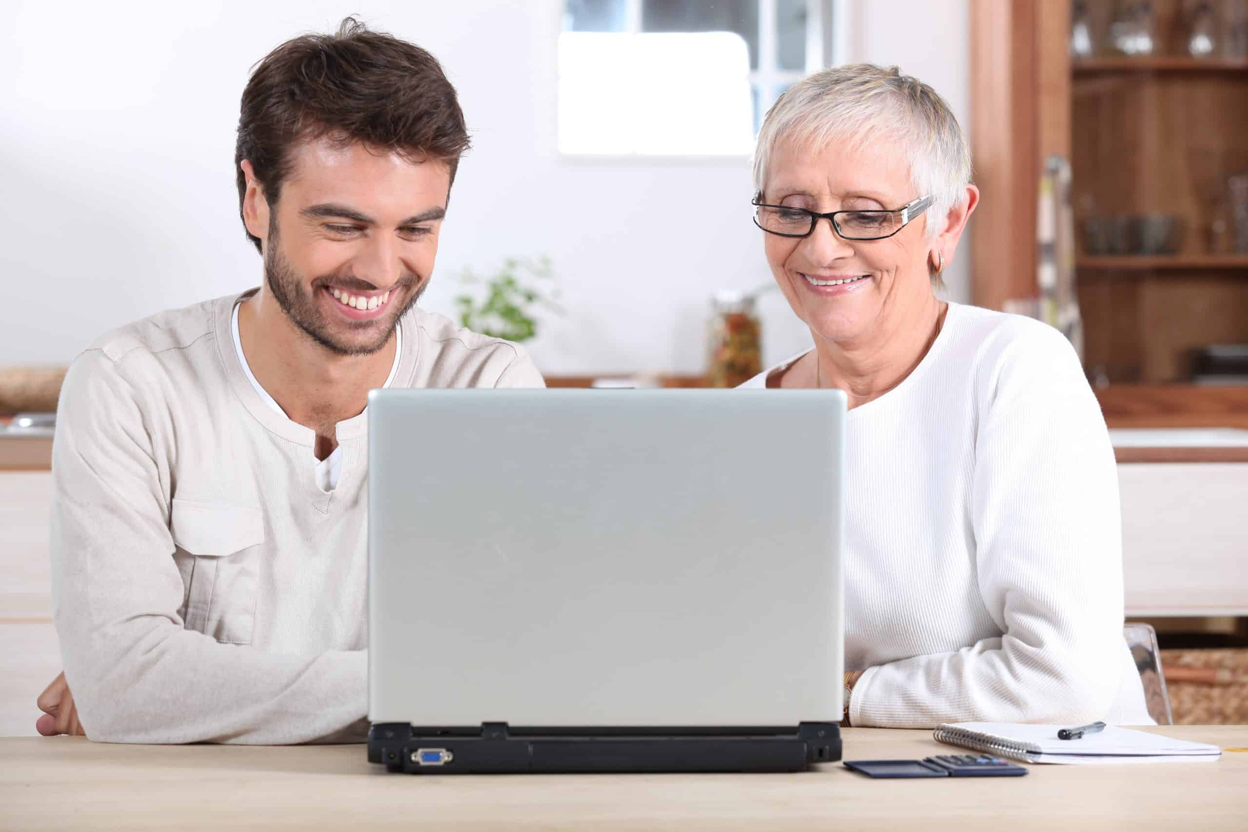 Free Mother's Day gifts - Young man and his mother using laptop