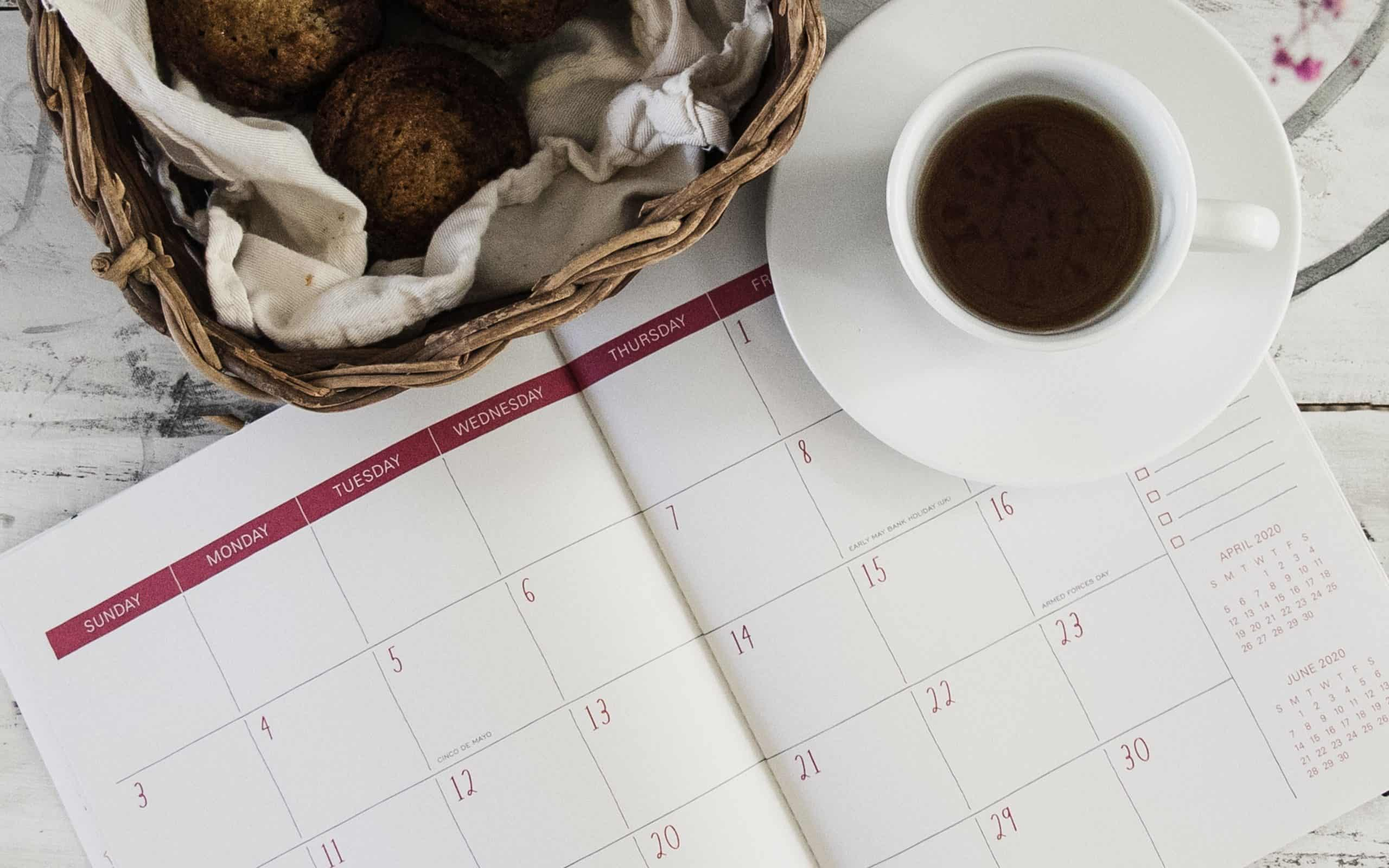 No spend month challenge - month calendar with cup of coffee