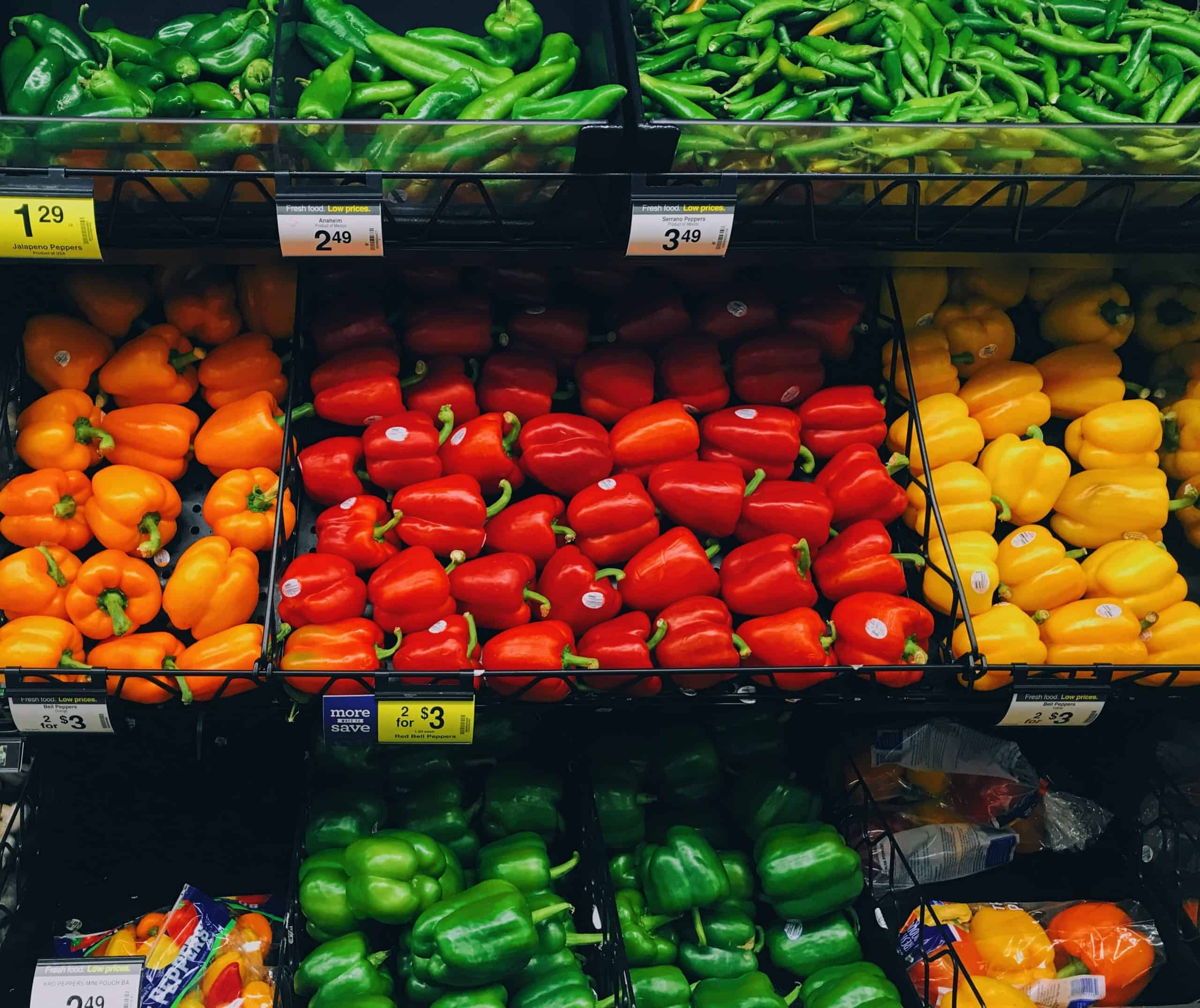 Eat healthy on a budget - Colored bell peppers on sale at supermarket