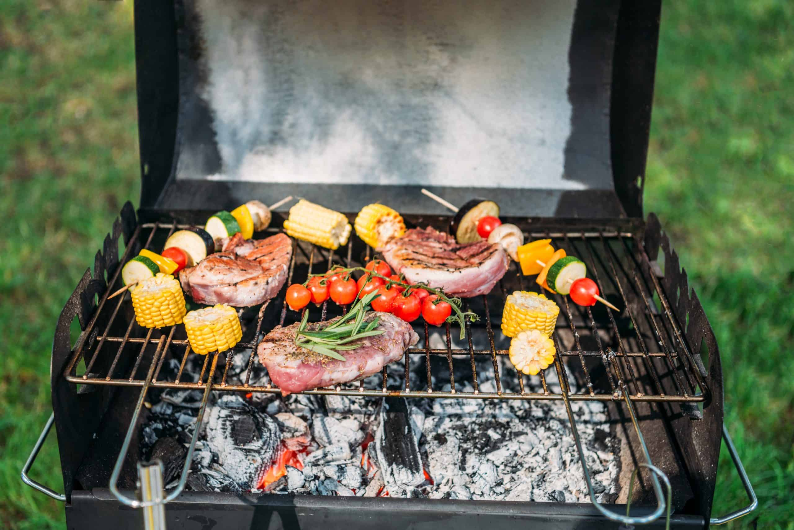 Barbecue safety tips - grill loaded with steak and vegetable skeweres