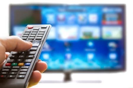 television remote pointing at smart tv apps