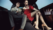 Two dressed-up people in a car on their way to a party